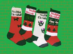 the christnas stocking scotty design with merry christmas in scottish gaelic and the shamrock design has